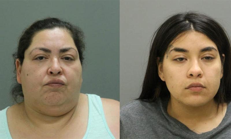 قتل کے الزام میں گرفتار خواتین — اے پی فوٹو