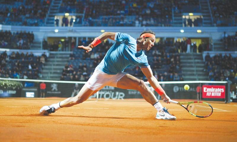 ROME: Rafael Nadal of Spain hits a return to Georgia's Nikoloz Basilashvili during their match at the Italian Open.—AP
