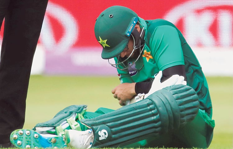 PAKISTAN opener Imam-ul-Haq reacts after being hit on his left elbow during the fourth ODI on Friday.—Reuters