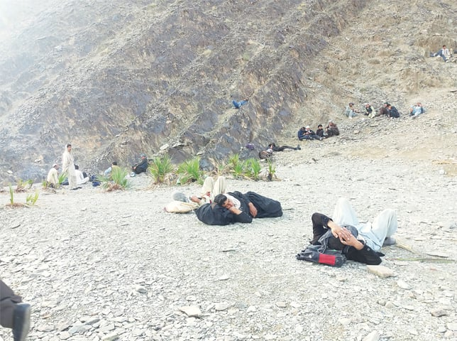 The Afghan immigrants rest at a spot in the mountainous area of Jodar.—Photo by writer