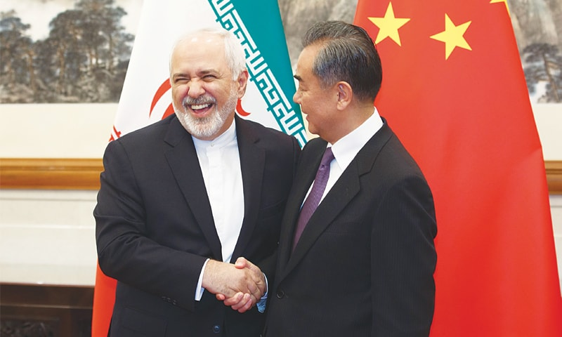 Beijing: China's Foreign Minister Wang Yi (right) meets Iran's Foreign Minister Mohammad Javad Zarif at the Diaoyutai State Guesthouse on Friday.—AFP