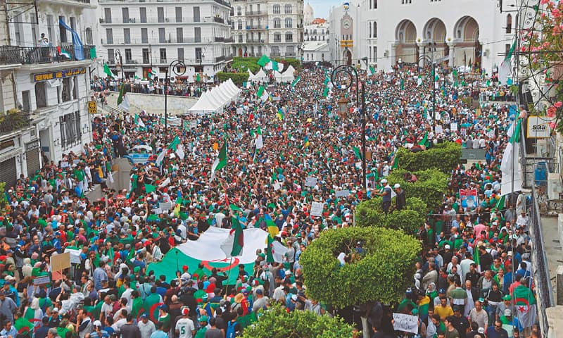 Algiers: Protesters gather outside the main post office for a demonstration against the Algerian government on Friday.—AFP