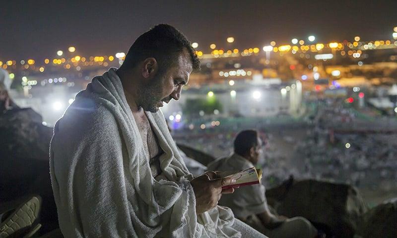 A pilgrim prays at Jabal Al Rahma, or the mountain of forgiveness, at Arafat for the annual Haj pilgrimage. —AP/File