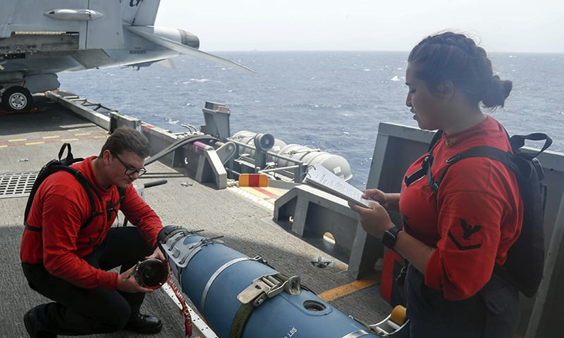 In this Wednesday, May 15, 2019, photo released by the US Navy, Aviation Ordnanceman 3rd Class Alexandrina Ross, right, and Aviation Ordnanceman Airman Hunter Musil, left, inspect a bomb on the USS Abraham Lincoln while it sails in the Arabian Sea. — AP