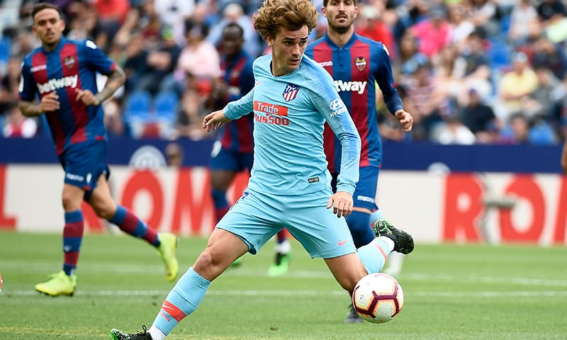 Atletico Madrid's French forward Antoine Griezmann controls the ball during the Spanish League football match between Levante and Atletico Madrid at the Ciutat de Valencia stadium in Valencia. — AFP