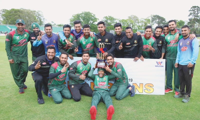 DUBLIN: Bangladesh cricketers celebrate the victory against West Indies in the Tri-Nation Series final at the Malahide cricket club.—AFP