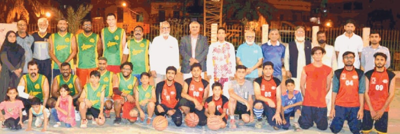 KARACHI: Competing basketball players are seen with chief guest Syed Salahuddin, Deputy Commissioner South, and other officials at the inauguration of the Mahmood Khan Trophy.