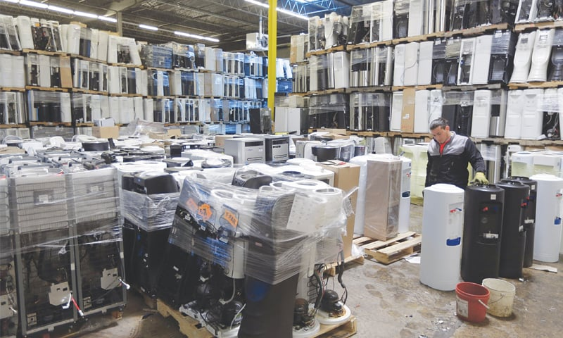 In this May 7, 2019 photo, water coolers are stacked and ready to be broken down into parts for recycling at a GDB International warehouse in Monmouth Junction, NJ. — AP