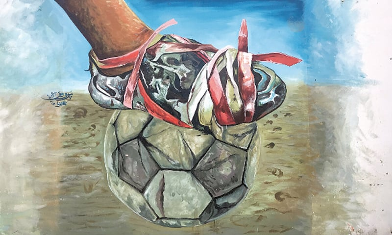 A mural of a tattered boot, held together with rags, kicking a slightly deflated ball | CEFA