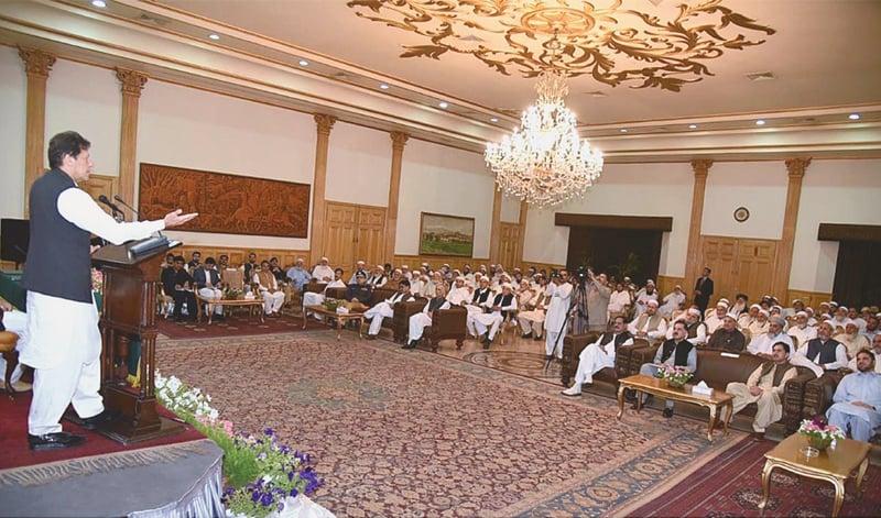 PESHAWAR: Prime Minister Imran Khan addresses elders of Khyber Jirga on Saturday.—APP