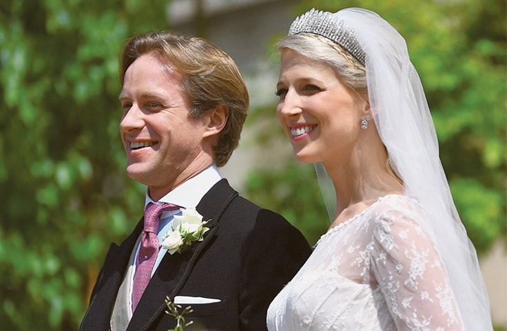 Newlyweds Thomas Kingston (left) and Lady Gabriella Windsor leave after their wedding ceremony at St George's Chapel in Windsor Castle on Saturday. Lady Gabriella is the daughter of Prince and Princess Michael of Kent. Prince Michael, is the Queen Elizabeth II's cousin.—AFP