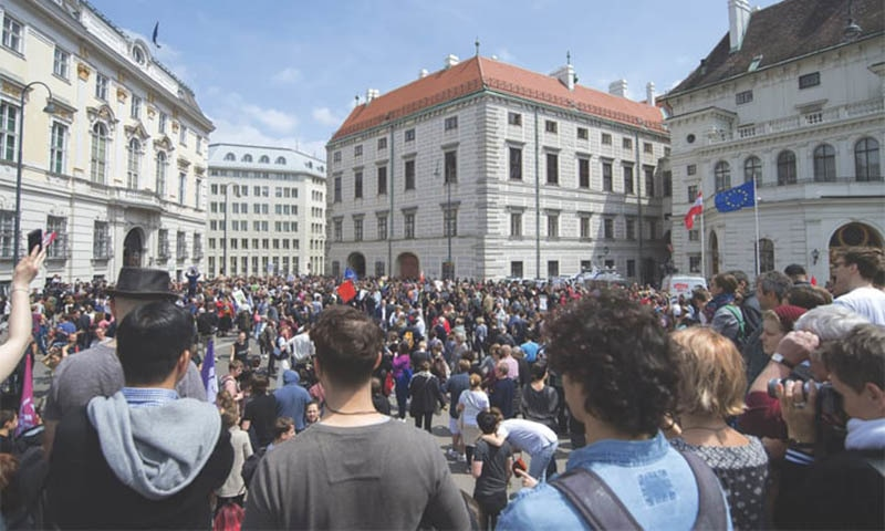 Protesters gather in front of the Chancellor's Office in Vienna on Saturday. —AP