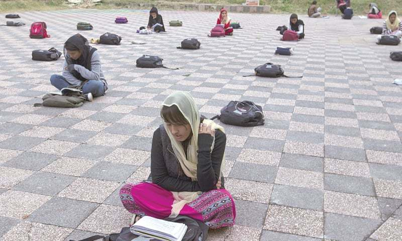 In this file photo, girls attend a makeshift school at an Islamabad park in November 2018. — AP