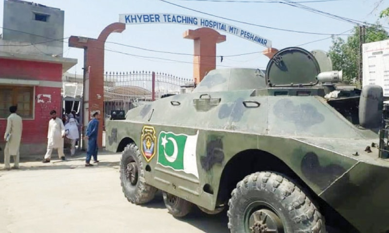 A police APC parked outside the main gate of Khyber Teaching Hospital, Peshawar. — Dawn
