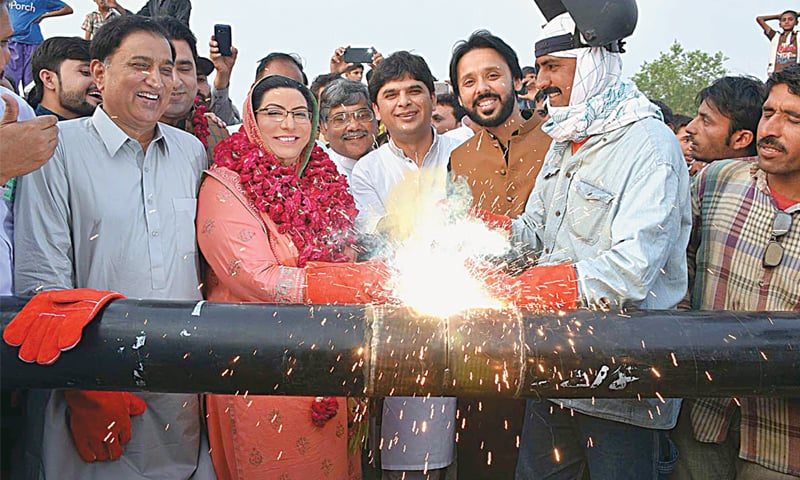 SIALKOT: Special Assistant to Prime Minister on Information Dr Firdous Ashiq Awan inaugurating a gas project at Kala Haraawaan village. —APP