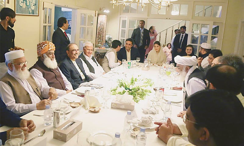 ISLAMABAD: Peoples Party chairman Bilawal Bhutto-Zardari exchanges pleasantries with opposition leaders before the Iftar dinner. Maryam Nawaz and JUI-F chief Maulana Fazlur Rehman are also seen.—PPI