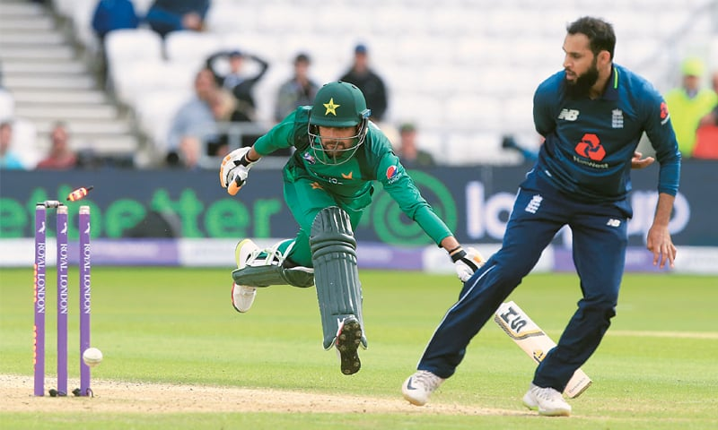 LEEDS: England's Adil Rashid manages to run out Babar Azam during the fifth One-Day International against Pakistan on Sunday.—AFP