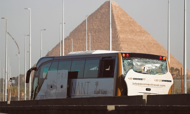 Cairo: The damaged bus near a new museum being built close to the Giza pyramids. — Reuters