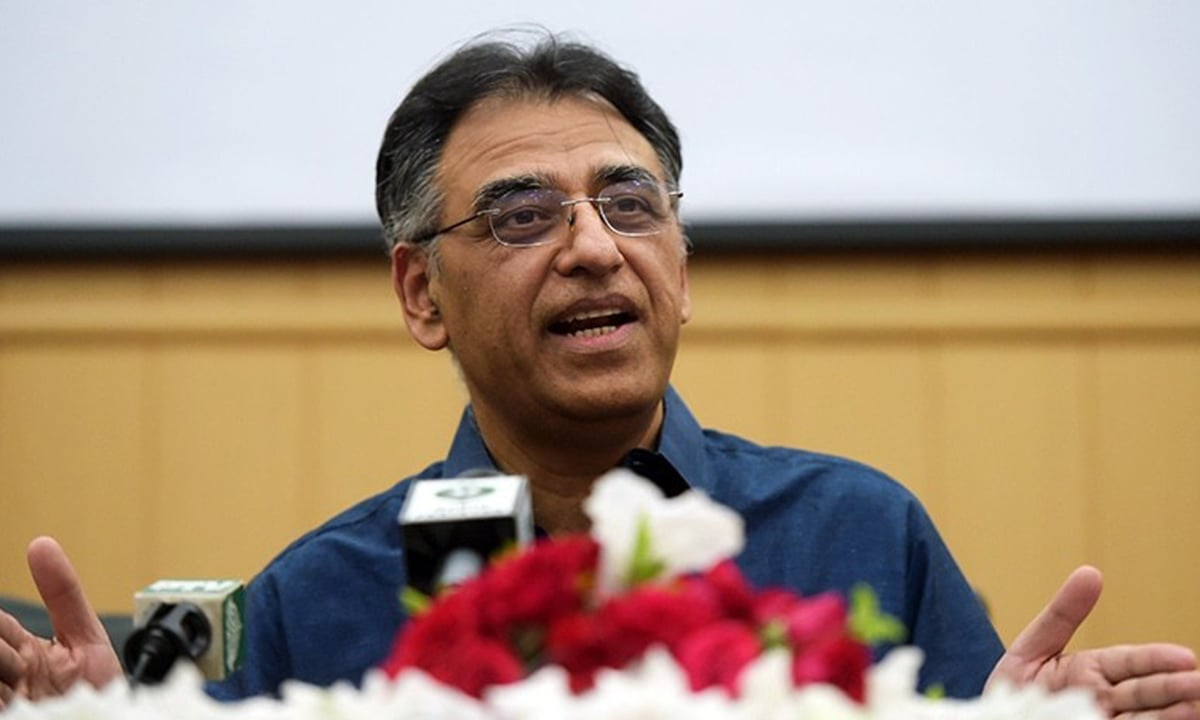 Asad Umar talking to the media after stepping down as finance minister | AFP