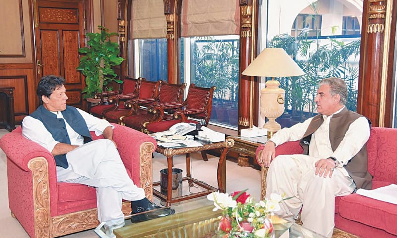 Prime Minister Imran Khan exchanges views with Foreign Minister Shah Mehmood Qureshi during a meeting at PM Office. — PPI