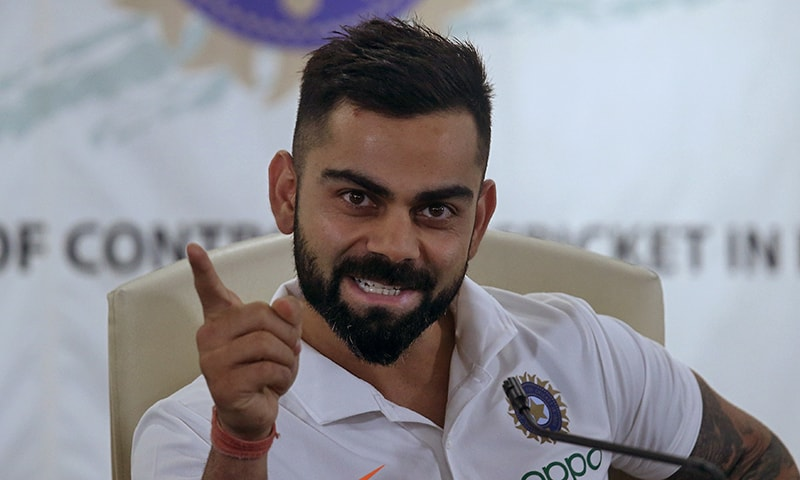 Virat Kohli gestures during a news conference at the Board of Control for Cricket in India (BCCI) headquarters in Mumbai. — Reuters