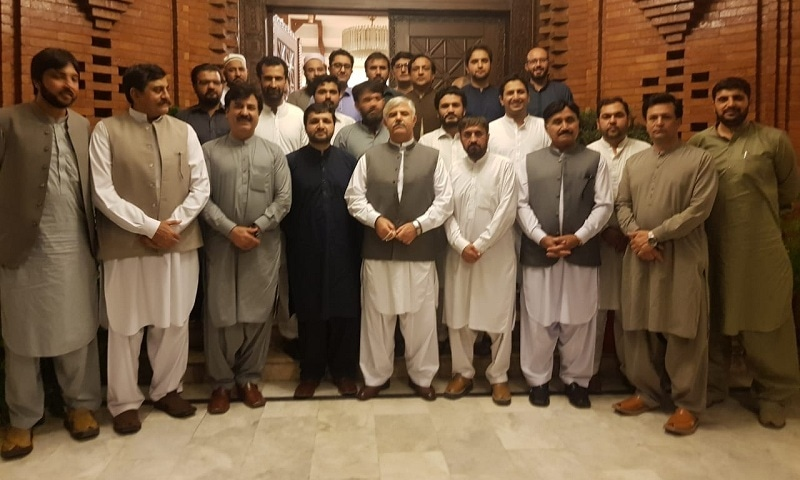 Members of doctor organisations and KP government pose for a photo following their successful negotiations. — Photo by author