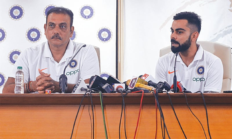 MUMBAI: Indian captain Virat Kohli (R) and head coach Ravi Shastri attend a press conference on Tuesday.—AP