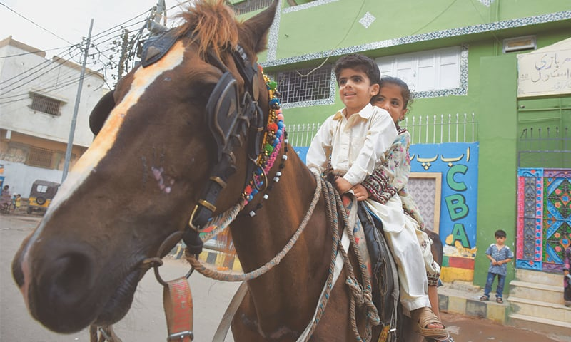 During Ramazan when the people do not frequent the beaches during the day for horse rides, the horse owners bring them to middle-class neighbourhoods for cheap rides.—Tahir Jamal/ White Star