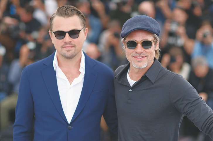"""US actors Leonardo DiCaprio (left) and Brad Pitt pose during a photocall for the film """"Once Upon a Time... in Hollywood"""" at the Cannes Film Festival on Wednesday.—AFP"""
