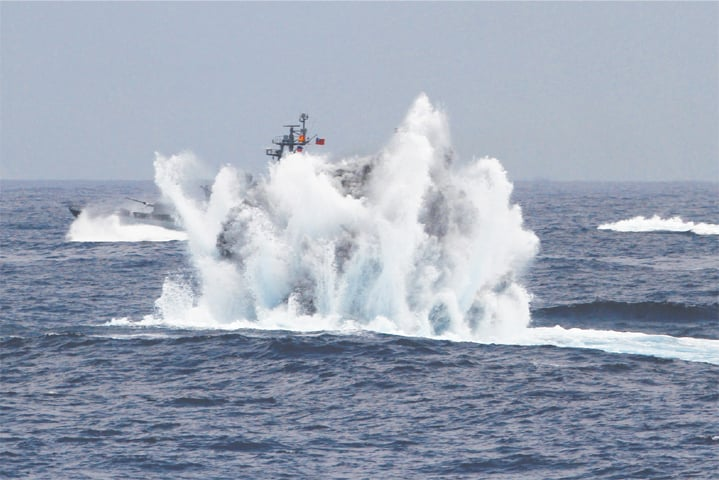 HUALIEN (Taiwan): Frigates simulate destroying an enemy submarine with depth charges during a live-fire drill at sea on Wednesday.—AFP