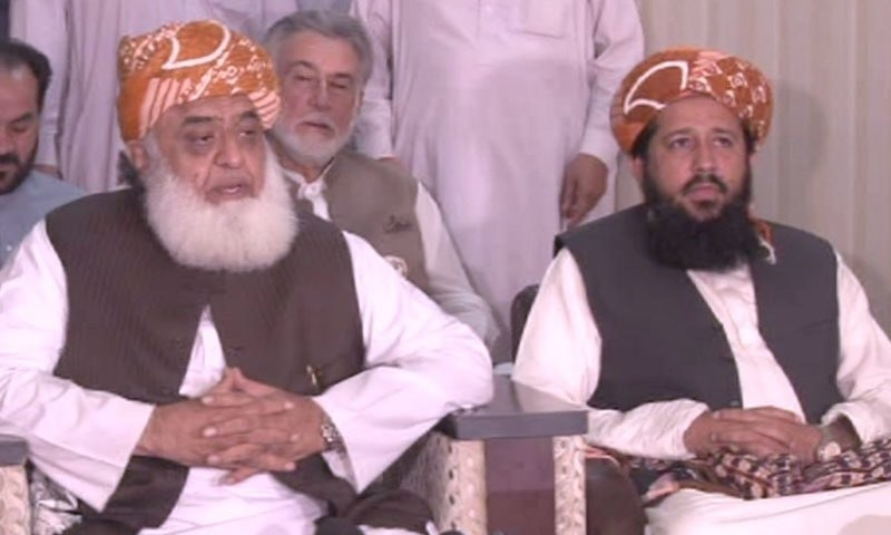 "Maulana Fazlur Rehman (left), chief of his own faction of the Jamiat Ulema-i-Islam (JUI-F) and head of the Muttahida Majlis-i-Amal (MMA), has directed his party workers to start preparations for a ""big"" anti-government ""protest demonstration"" to be held in Islamabad soon, invi­ting other parties to join it. — DawnNewsTV/File"