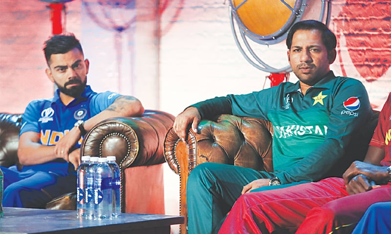 LONDON: Pakistan's Sarfraz Ahmed is seated next to India's Virat Kohli during the captains press conference on Thursday.—AP