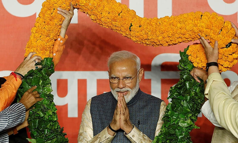 Indian Prime Minister Narendra Modi gestures as he is presented with a garland by Bharatiya Janata Party (BJP) leaders after the election results in New Delhi, India on May 23, 2019. — Reuters