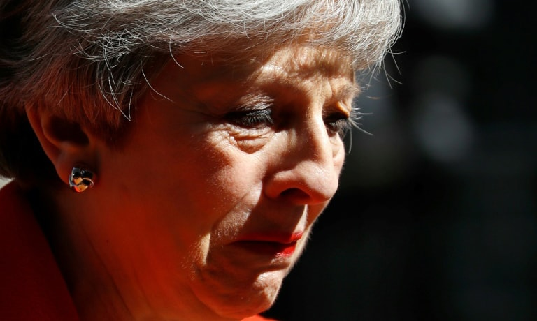 Britain's Prime Minister Theresa May in an emotional address on Friday said she would step down as Conservative Party leader on June 7. — AFP