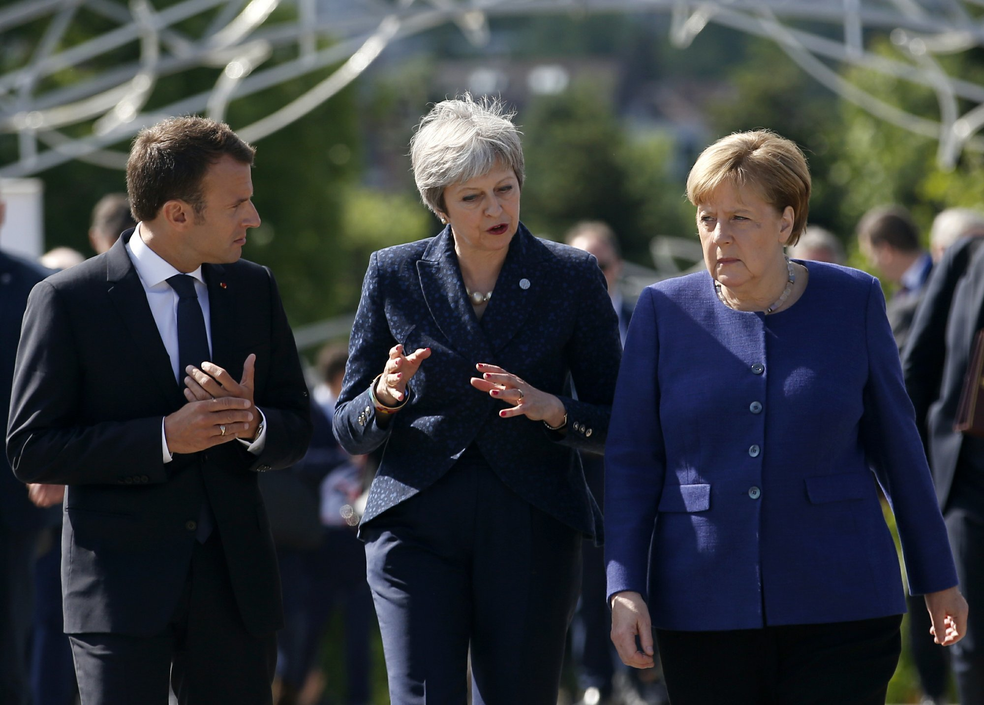 In this May 17, 2018 file photo, German Chancellor Angela Merkel, right, speaks with French President Emmanuel Macron, left, and British Prime Minister Theresa May after meeting at a hotel on the sidelines of the EU-Western Balkans summit in Sofia, Bulgaria. — AP
