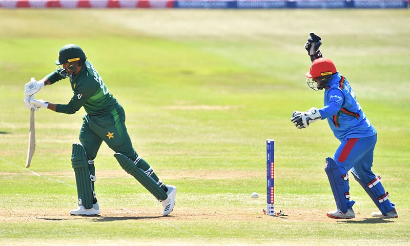 Pakistan's Fakhar Zaman (L) is bowled by Afghanistan's Mohammad Nabi as Afghanistan's Shahzad Mohammadi looks on during the 2019 Cricket World Cup warm up match between Pakistan and Afghanistan at Bristol County Ground in Bristol, southwest England, on May 24. — AFP