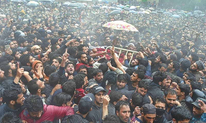THOUSANDS of villagers attend the funeral of Zakir Musa in Tral, south of Srinagar, on Friday.—AFP