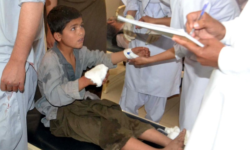A boy injured in a bomb blast in a mosque receives treatment at a hospital on Friday. —INP