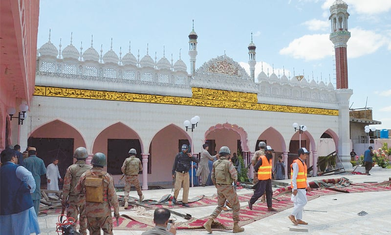 QUETTA: Security personnel cordon off Rehmania Mosque after a bomb ripped through it before Friday prayers. Two people lost their lives in the blast.—Online