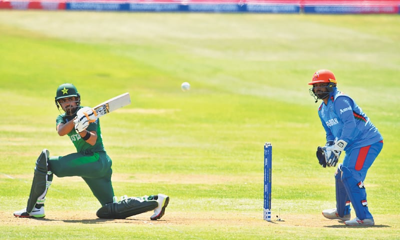 BRISTOL: Pakistan batsman Babar Azam pulls during his century in the World Cup warm-up against Afghanistan at Bristol County Ground on Friday.—AFP