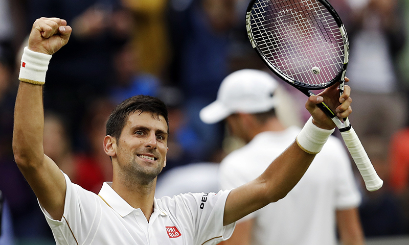 Novak Djokovic of Serbia celebrates after beating Adrian Mannarino of France in their men's singles match on day three of the Wimbledon Tennis Championships in London, Wednesday, June 29, 2016. — AP