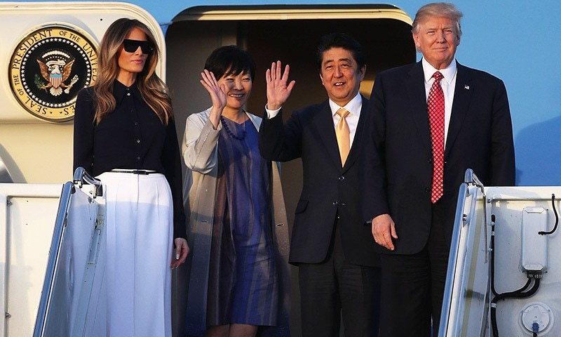 Abe drives Trump around golf course near Tokyo