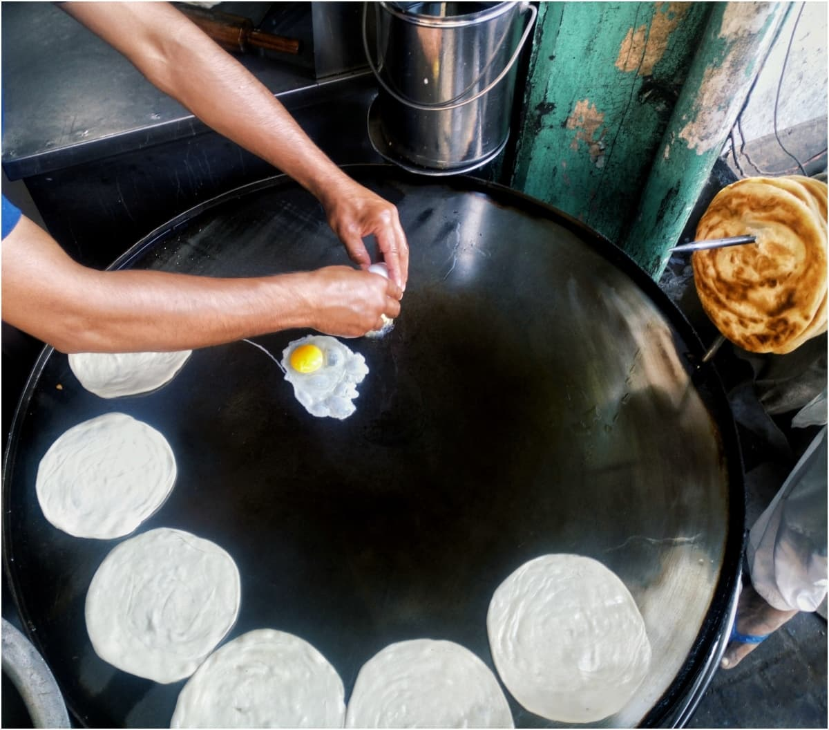 The egg and paratha in preparation