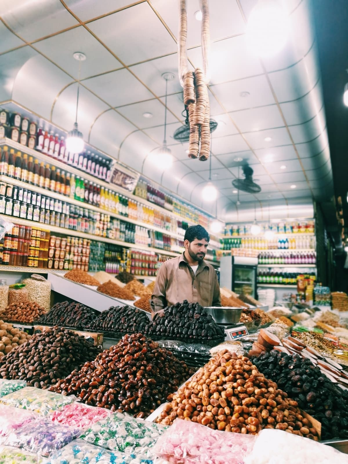 A shopkeeper and his dry fruits stall