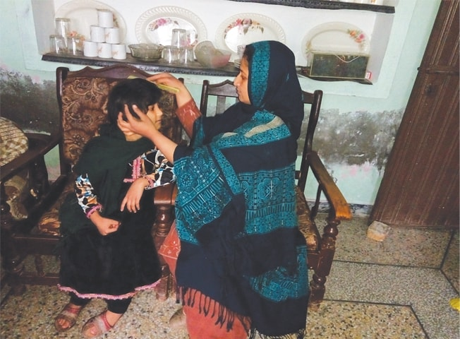 Bushra Tabassum takes care of her child as she tries to forget the trauma she suffered