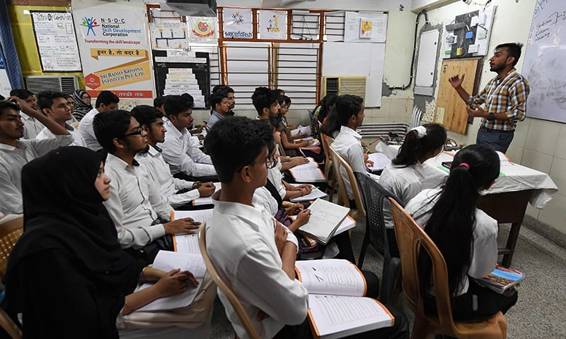 Indian youths at a class for a three-month course on computer hardware. ─ AFP
