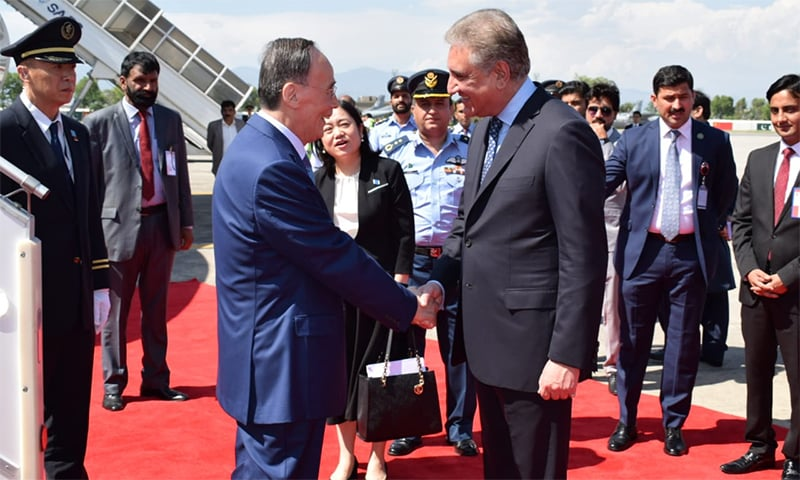 Foreign Minister Shah Mahmood Qureshi receives Chinese Vice President Wang Qishan upon his arrival at Nur Khan airbase. ─ Photo courtesy Naveed Siddiqui