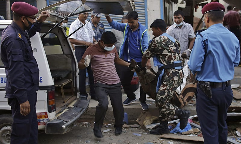 The body of a victim is removed from the site of an explosion in Kathmandu, Nepal, Sunday, May 26. — AP