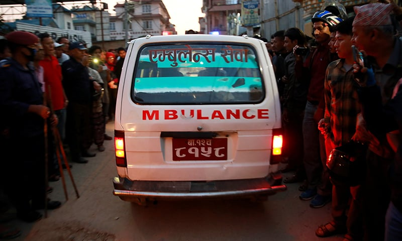 An ambulance carrying a victim's body leaves an explosion site in Kathmandu, Nepal. — Reuters