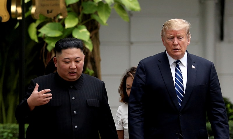 North Korea's leader Kim Jong Un and US President Donald Trump talk in the garden of the Metropole hotel during the second North Korea-US summit in Hanoi, Vietnam February 28, 2019. — Reuters